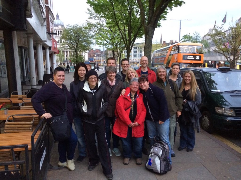 Photo of a group of writers standing on a street in Nottingham, England and smiling.